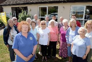 Chairman Ann Martin (front left) with members outside Milward Court in Shoreham. Photo by Kate Shemilt