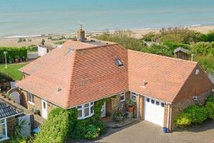 This five-bedroom detached house in picturesque Ferring is right on the seafront.