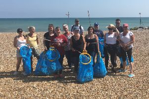 Staff from Equiniti in Worthing supporting Surfers Against Sewage by clearing rubbish left on Goring beach