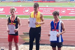 Bailey Smith (centre) on top of the podium at the English Schools Championships