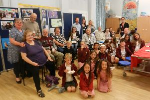 Bianca Donnelly, founder of Great 2 Create, right, Lis Telcs, teacher at Swiss Gardens Primary School, left, and Peter Hornsby, co-ordinator of Age UK West Sussex's Adur Community Clubs, centre, with year-five pupils and their guests at the community tea party