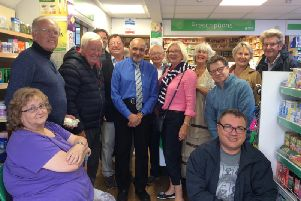 Shabbir Jafferali (centre, with tie) surrounded by customers, friends and councillors SUS-190813-093914001