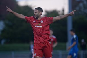 Alex Parsons celebrates his second goal in Worthing's win over Lewes. Picture by Marcus Hoare