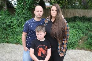 Marc Grove, Victoria Howlett and Oliver Torrey where their cat was stolen. Picture: Derek Martin