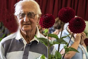Ted Banks with his dahlias, which scooped all the top prizes