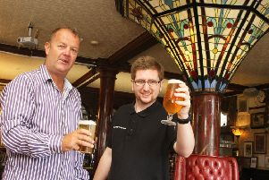 Gary May, new manager at the Grand Victorian Hotel in Worthing, with barman Josh Riley, right. Photo by Derek Martin DM1990017a