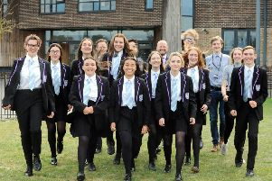 Morgan Thomas, principal of The Littlehampton Academy, back centre right, and pupils delighted with their Ofsted report