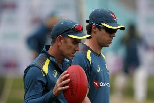 Travis Head with coach Justin Langer / Picture by Getty Images