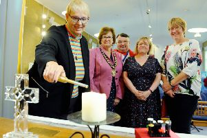 The Rev Dawn Carn lights the peace candle to launch Worthing Mental Health Awareness Week, watched by mayor Hazel Thorpe, the week's co-founders Bob Smytherman and Carol Barber, and Val Turner, executive member for health and wellbeing. Picture: Kate Shemilt ks190553-1