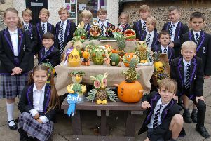 Year-five pupils with their veg-heads for the annual competition