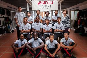 Marike Colyn, centre manager at ELH South Africa, with the boys at the Ubuntu Football academy in Cape Town