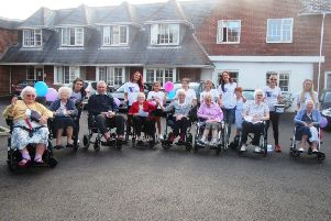 Staff and residents at Oakland Grange, ready for the four-mile sponsored walk around Littlehampton