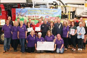 Cheque presentation at Worthing Fire Station. Picture: Eddie Mitchell.