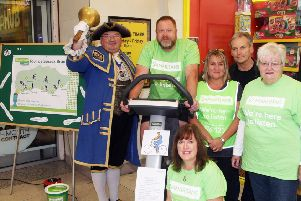 Worthing town crier Bob Smytherman launches Worthing Samaritans' static cycle ride. Photo by Derek Martin DM19105064a