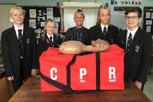 Science teacher Jaimie Eason and Durrington High School students with the CPR kit provided by the British Heart Foundation
