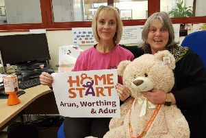 Celebrating the BBC Children in Need grant in the Arundel office of Home-Start Arun, Worthing and Adur