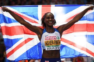 Dina Asher-Smith celebrates winning gold in the Women's 200 metres final during day five of the 24th European Athletics Championships at Olympiastadion in Berlin (Photo by Matthias Hangst/Getty Images)