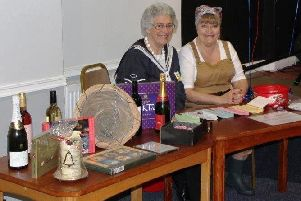 Raffle ticket sellers Lynne and Jan dressed as a 1940s Naval auxiliary and Land Girl