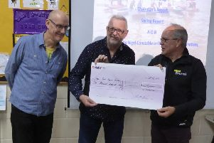 John Rideau and Nigel Constable from Arundel-based rock band The Alternatives present the cheque to chief RYA instructor Richard Renson