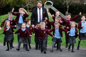 Headteacher James Field and some of the children from St Robert Southwell Catholic Primary School