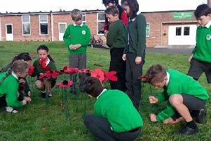 Planting poppies at Greenway Academy