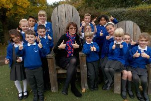 Headteacher Rachel Nunns and some of the Castlewood Primary children