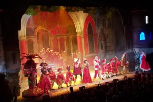 The cast belting out a number