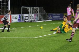 Horsham's Toby House guides home a late consolation goal against Corinthian Casuals. Pictures by John Lines