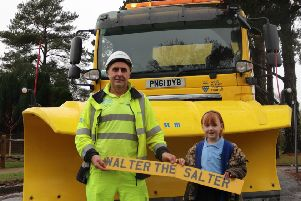 Chloe is pictured with gritter driver Mick Honeywood, from Balfour Beatty Living Places