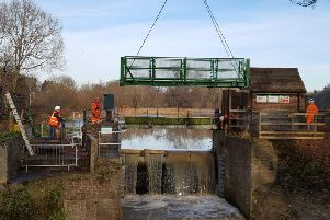 Richard Symonds submitted this photo of a new footbridge being winched into place across the millpond sluice, between the Warnham Nature Reserve Visitors Centre and the Warnham Mill.