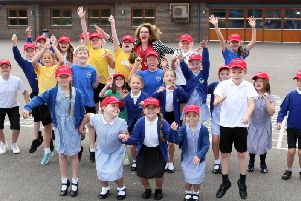 Headteacher Sue Harrison and some of her pupils celebrate Steyning Primary School's good Ofsted report