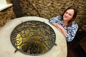 What's down there? Landlady Lucie Sargent beside the old well