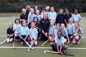 Leah Wilkinson with the school's girls hockey team