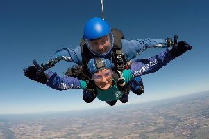 Tanya Ellett, pictured mid-skydive, has raised more than �1,800 for St Barnabas House