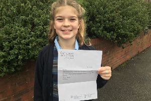 Cecilia Beddison with her letter from the National Children's Choir