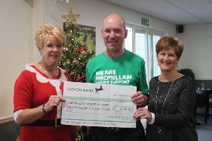 The ladies in the picture are Clair Milton, captain (on left) and Brenda Holman, committee member and fundraiser (on right). Ray Chick, the treasurer, is receiving the cheque