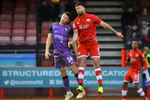 Crawley Town's Ollie Palmer and Port Vale's Adam Crookes go up for a header.'Picture by Steve Robards