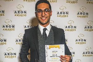 Thanbir Moktadir, owner of Horsham Tandoori, with his ARON award SUS-190121-154718001