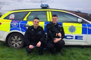 Police officers with Reggie the puppy. Photo: South Wales Police in Swansea/Twitter