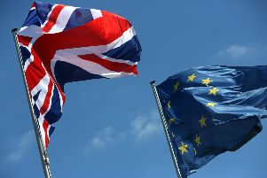A British Union Jack and European Union flag fly 655846159