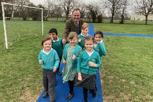 Arundel & South Downs MP Nick Herbert with pupils from St Peter's CE Primary School in Henfield on the 'St Peter's Metres' running track SUS-190213-104008001