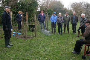 Roger Brown, left, a Steyning Community Orchard steering group member and expert on fruit trees, talks to supporters before the tree planting