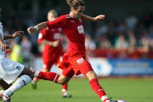 CRAWLEY, WEST SUSSEX - OCTOBER 01:  Sergio Torres of Crawley Town in action during the Npower League Two match between Crawley Town and Plymouth Argyle at the Broadfield stadium on October 1, 2011 in Crawley, West Sussex.  (Photo by Clive Rose/Getty Images) SUS-180123-000914002