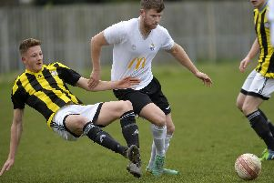 Tim Bennett (left) puts a foot in as Sam Karl watches on during Loxwood's defeat to Eastbourne United. All pictures by Jon Rigby.