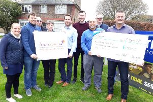 Jason Hayes, third from the right, presents the cheque to Shaun Santer, far right
