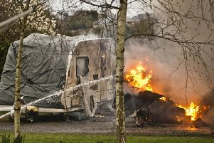 Eight fire engines were called to the blaze which destroyed four caravans and a campervan. Photo by Eddie Howland