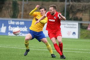 Alex Barbary (in red) put Horsham YMCA ahead in their 1-1 draw with Newhaven. Picture by Derek Martin.
