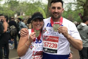 Joanna and Rikky with their London Marathon medals