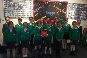 Greenway Academy pupils with the defibrillator SUS-190513-152701001