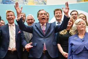 Brexit Party leader Nigel Farage speaks to the media as he stands with newly elected Brexit Party MEPs. (Photo by Peter Summers/Getty Images)